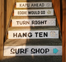 Hand-painted signs on the steps